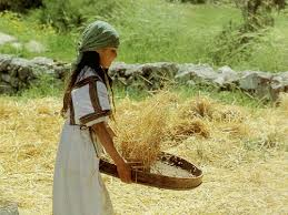 Girl winnowing wheat